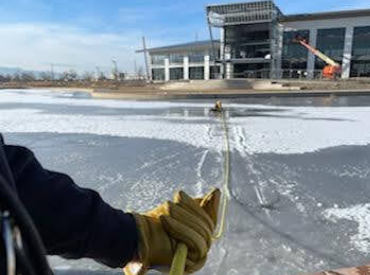 Hands pulling in rope for ice rescue